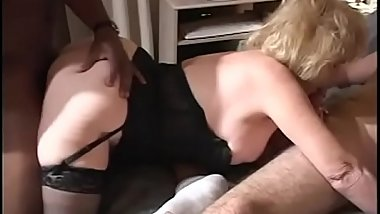 Mature slut rides black cock while sucks white cock