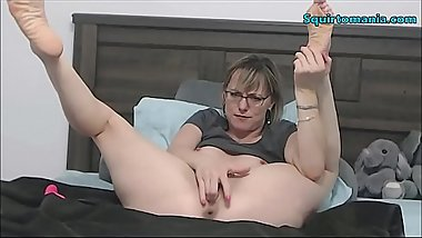 Mature Woman with Glasses and Short Hair Squirting
