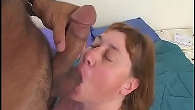 The older at chick sucks hard while she rubs her pussy