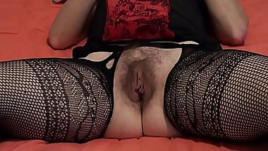Keeps her legs wide apart masturbating her hairy beaver to orgasm