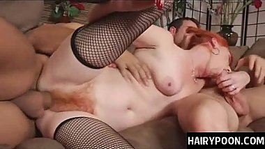 Mature redhead babe with hairy twat works two dicks