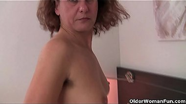 Hairy grandma Inge in red stockings is fingering her full bushed pussy