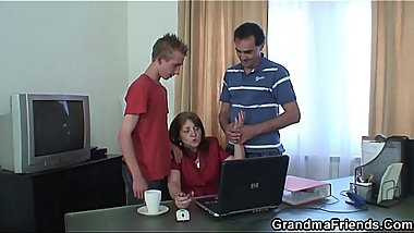 Hairy granny swallows two cocks at once in the office