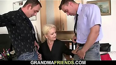 Hairy granny spreads legs for two men